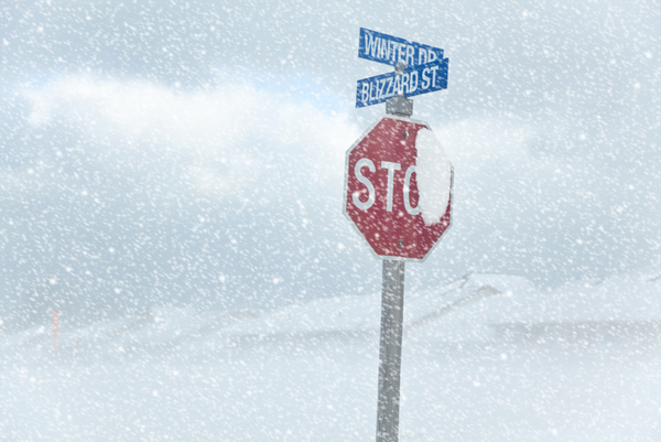 A-stop-sign-on-the-corner-of-Winter-Dr.-and-Blizzard-St.-in-the-middle-of-a-blizzard