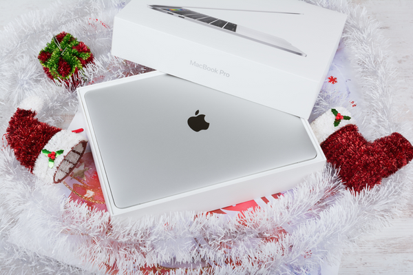 New-MacBook-Pro-in-a-box-surrounded-by-Christmas-decorations