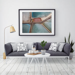 picture hanging on wall abstract art and couch with black frame