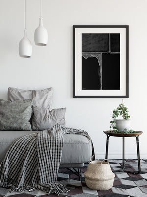 Black and white framed print on wall in black frame abstract
