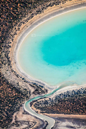 Aerial image of salt pond in Western Australia with blue and red sand