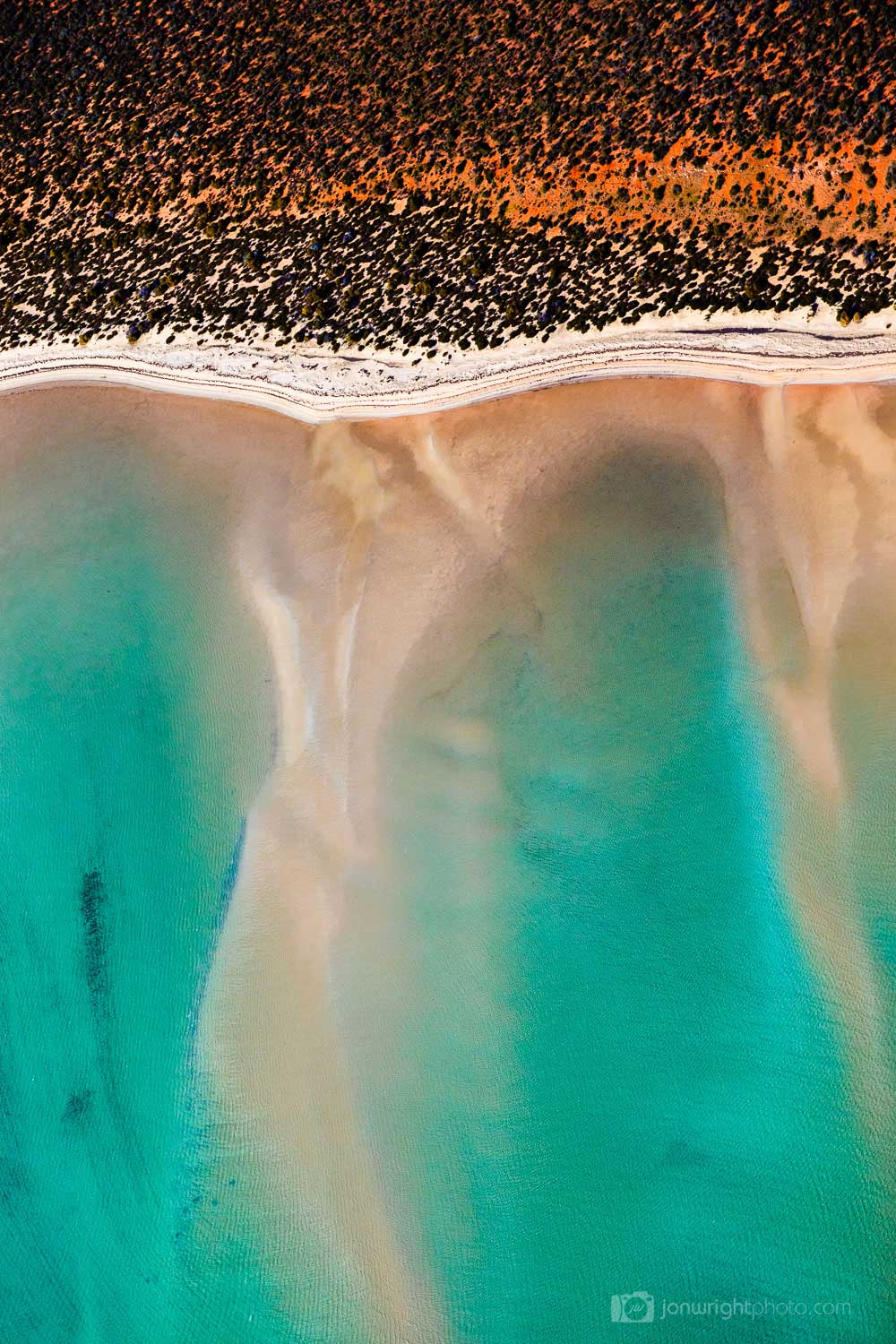 Red and Turquoise aerial abstract image of ocean