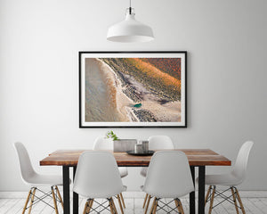 White framed earth tone abstract artwork on wall with pastel colours