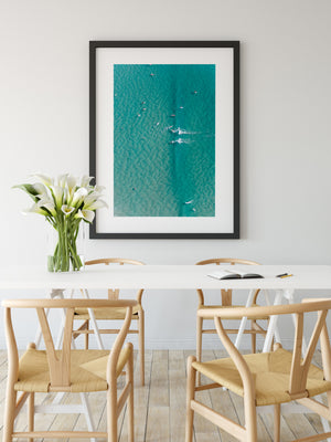 Gold Coast Beach Print black frame in room