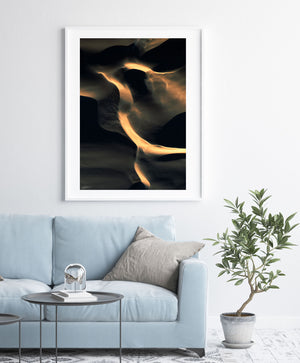 black and gold abstract wall art and print on wall with contemporary styling