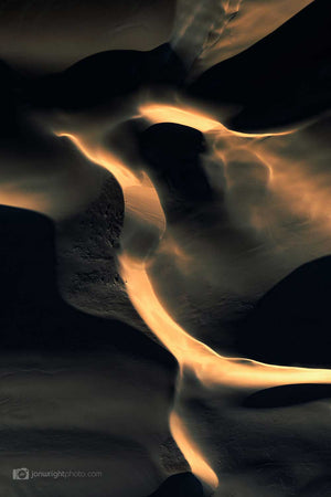 Sand dunes at sunset with dark shadows similar to an eagle