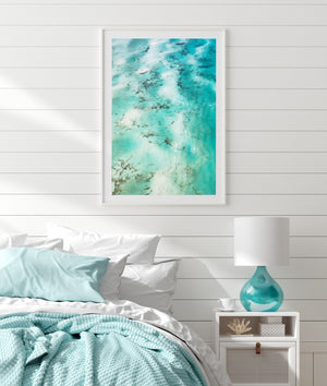 Turqoiuse wall art with white frame of abstract aerial art