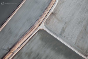 Abstract aerial art and photography of brushed grey salt ponds