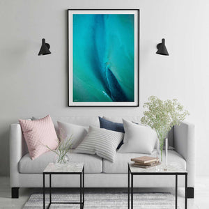 Blue and green abstract aerial wall art in black frame and modern styling