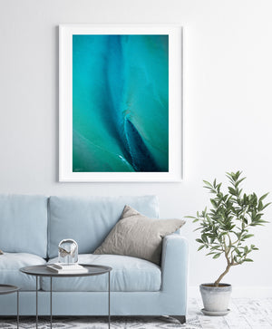 Blue and green abstract aerial wall art in white frame and modern styling
