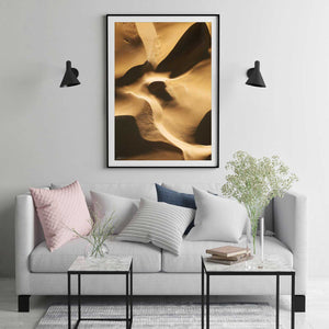 Abstract aerial print of sand dunes with golden tones framed in black