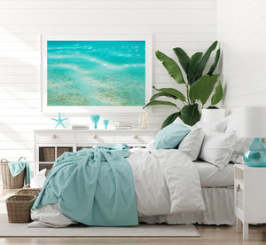 White Framed wall art with beach print in the middle