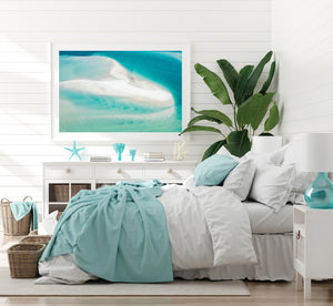 Turquoise framed print in a white frame bedroom