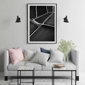 Black frame with white matt board black and white abstract print in modern room