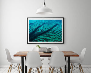 clean modern interior with abstract blue green art in black frame