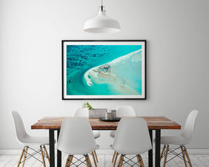 Abstract Aerial Art hanging on modern wall with black frame and turquoise colours