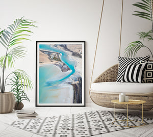 Pastel colour artwork in frame laying on wall with black frame and white matt board