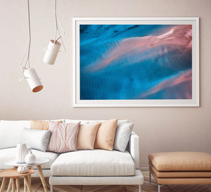 Contemporary interior with pastel colours and abstract art hanging on wall