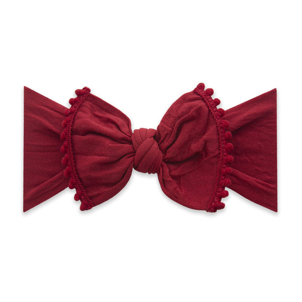 Mini Pom Trimmed Knot Bow Headband - Winter Red