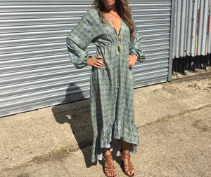 Ethically made maxi dress with ruffle hem, long puff sleeve and deep V neck