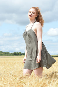 Ethically made summer mini dress with racer back, side view