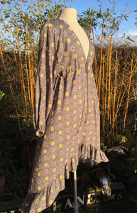 Ethically made maxi dress with ruffle hem, long puff sleeve and deep V neck. Grey print