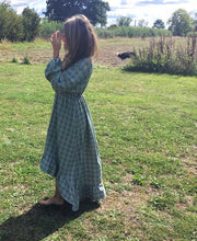 Load image into Gallery viewer, Ethically made maxi dress with ruffle hem, long puff sleeve and deep V neck. Side view
