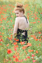 Load image into Gallery viewer, Ethically made Backless, wide leg, halter neck jumpsuit with tie back, back view in black