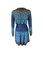 Load image into Gallery viewer,  Wool mix stretch wrap mini dress with long sleeves. Ethnic print. Back view
