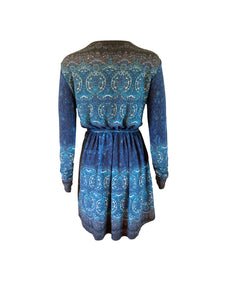 Wool mix stretch wrap mini dress with long sleeves. Ethnic print. Back view