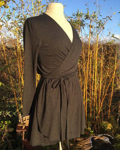 Ethically made stretch wrap mini dress with tie waist and gathered skirt. Black