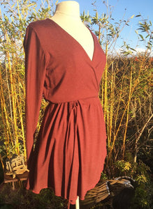 Ethically made stretch wrap mini dress with tie waist and gathered skirt. Burgundy
