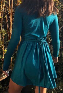 Ethically made stretch wrap mini dress with tie waist and gathered skirt. Back view