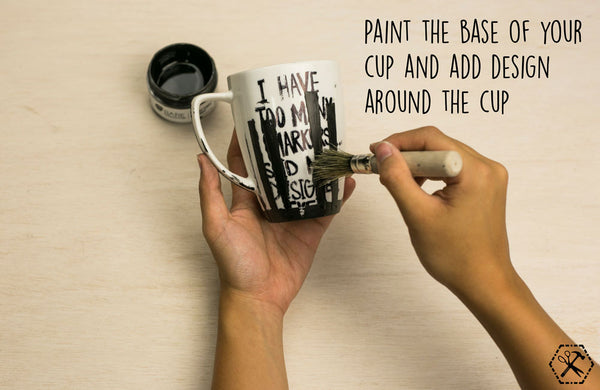 paint the base of your cup and add design around the cup