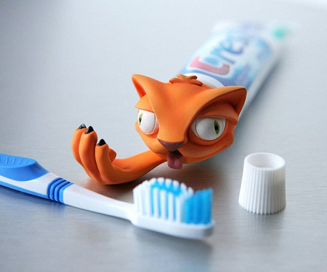 Puking Cat Toothpaste Dispenser
