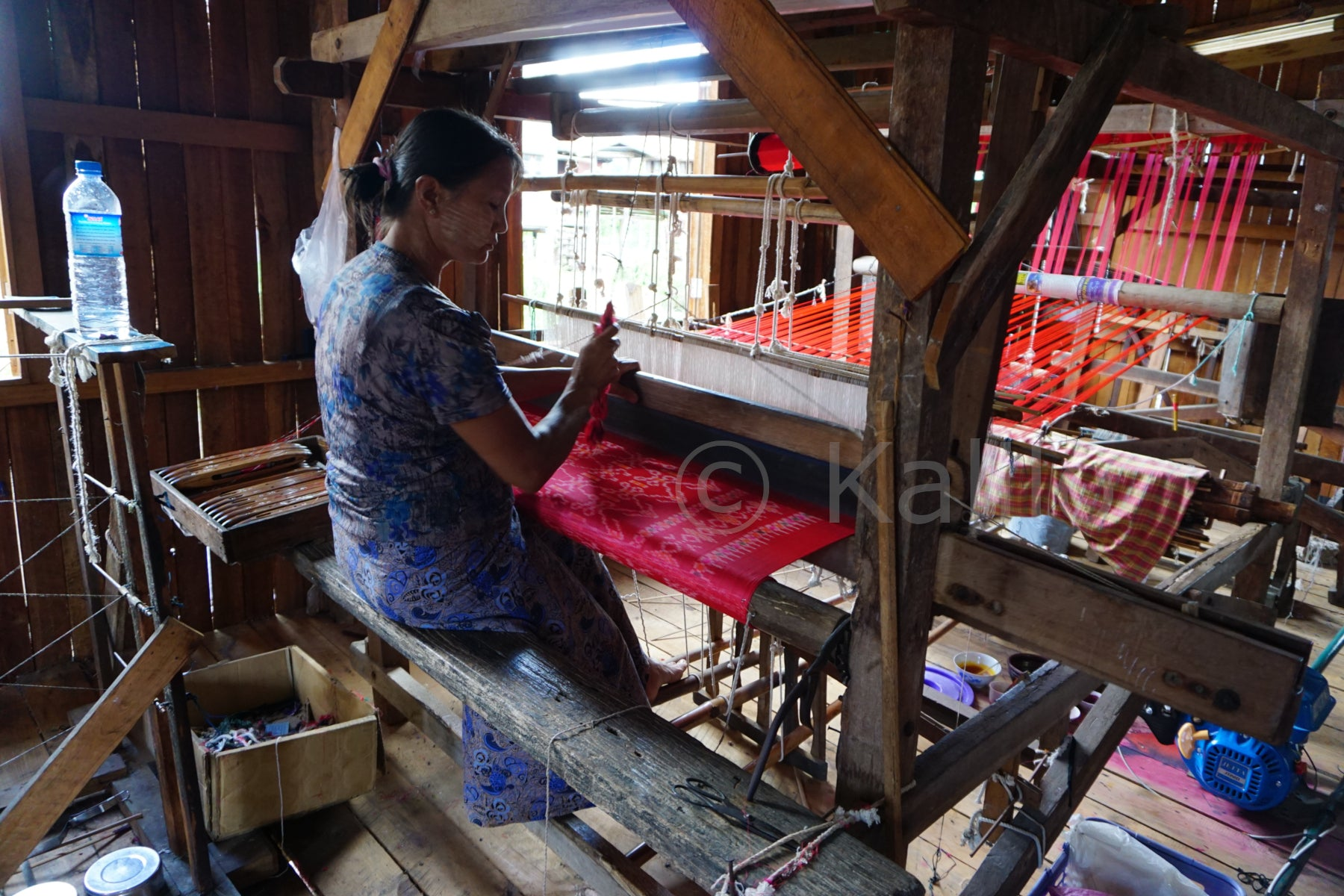 A woman weaving lotus fabric - Inle lake, Myanmaar
