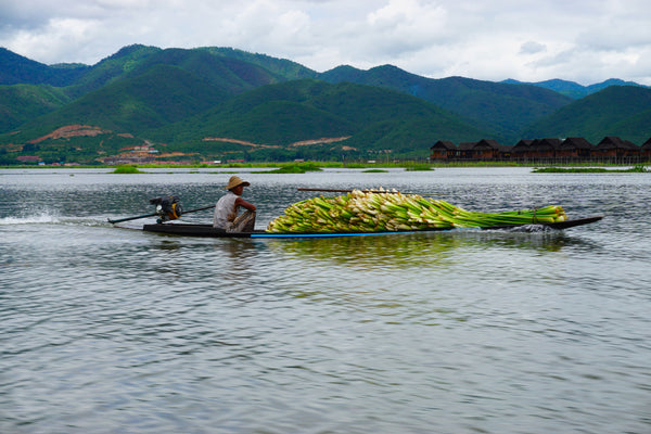 Man transporting goods on his boat. Kalilo - We work with natural, high quality, and eco-friendly products