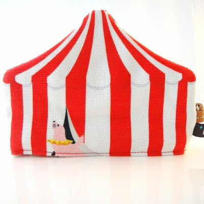 Red circus tent with seal