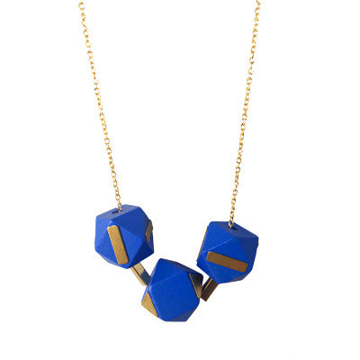 Indigo and brass wooden geometric bead necklace