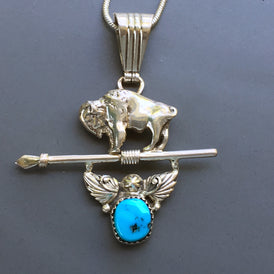 A Navajo Sacred Buffalo Pendant with Spear and Turquoise, Sterling