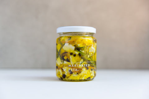 jar of spice and green orange and rosemary marinated feta