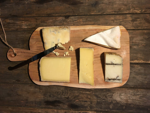 seasonal cheeseboard for winter with cheddar, blue cheese, vacherin, truffle pecorino and comte