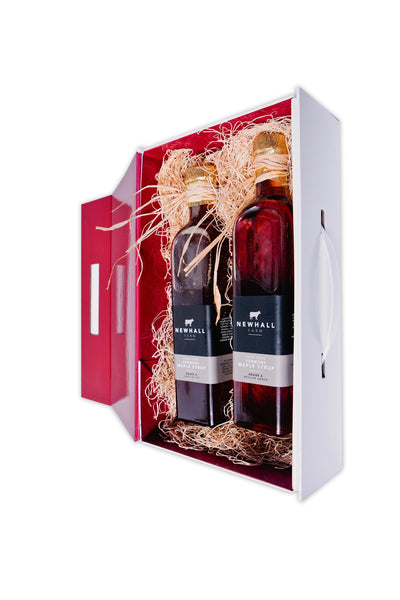 Newhall Farm Vermont Maple Syrup in a standing white and red gift box with magnetic closure. Suitcasefullofflavor