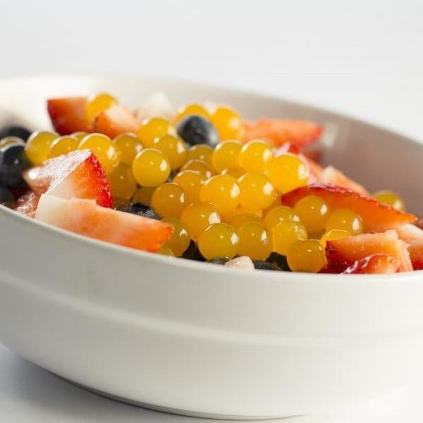 Mango Bursting Boba® on fruit bowl - BossenStore.com