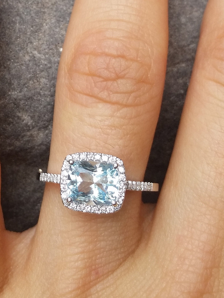 Aquamarine & Diamond Halo Ring on hand