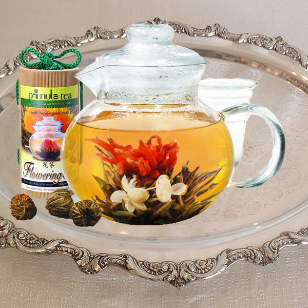 Clear Teapot With Blooming Flowers Tea