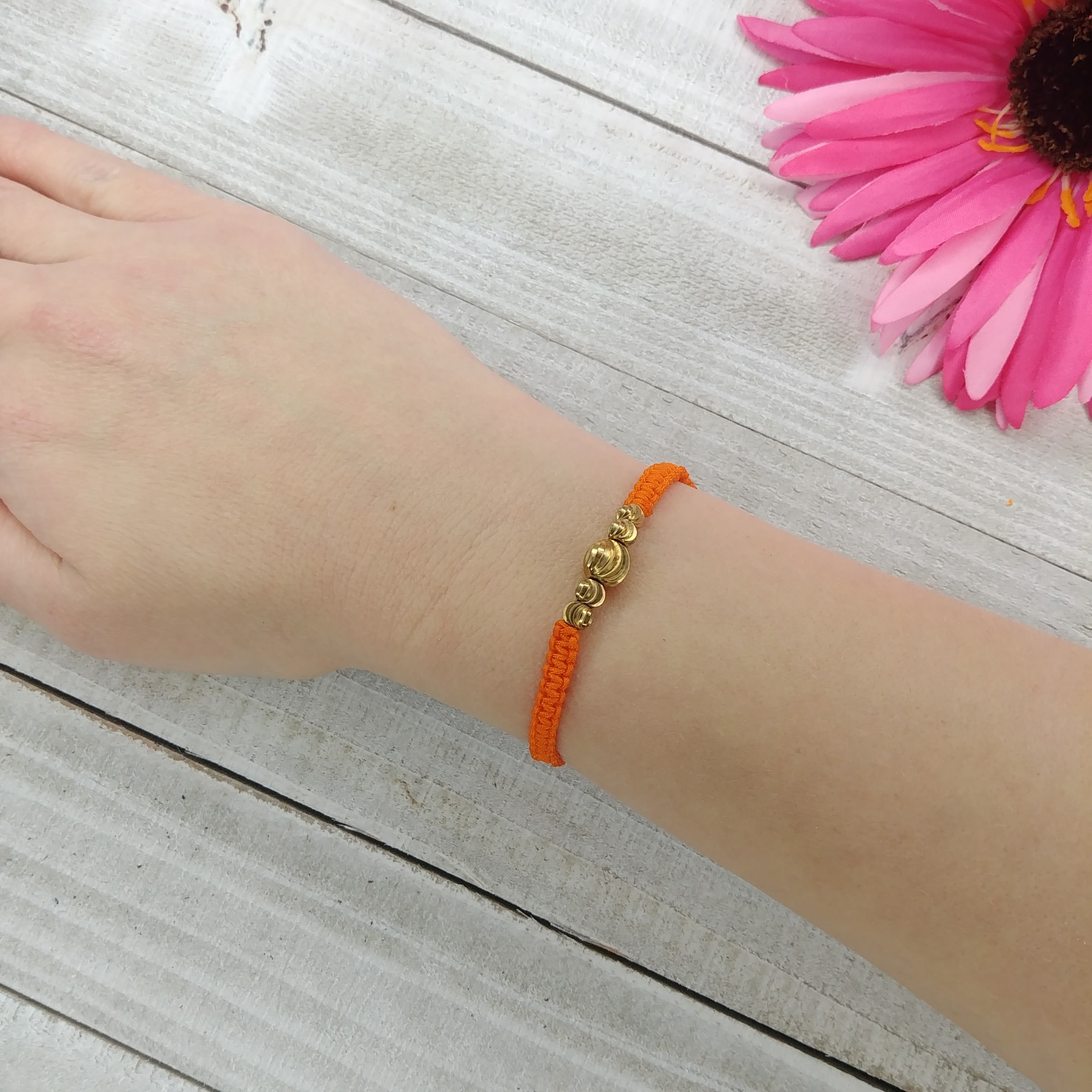 Braided Orange and Gold Bracelet