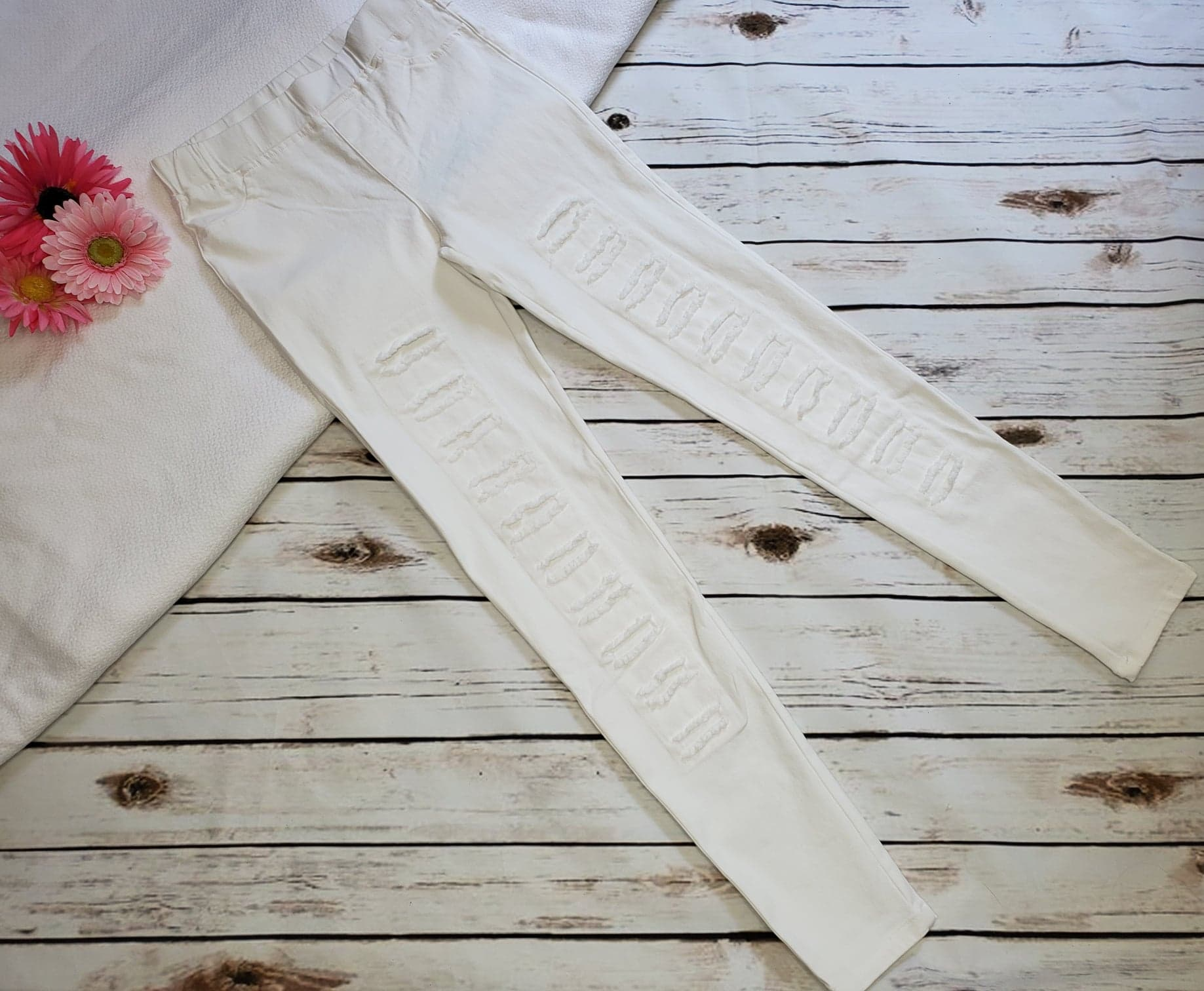 Distressed Cream Jeggings