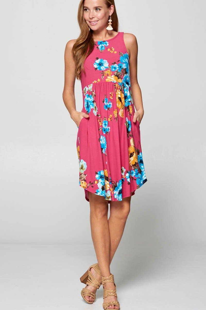 Looking for a summer mid length dress? This sleeveless fuchsia floral dress is perfect for any occasion. Available in S-3XL.