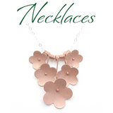 Shop Necklaces Handmade botanical jewelry inspired by flowers and nature in sterling silver rose pink red gold Susan Harbourt Designs
